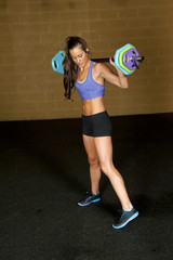 Profile View of A Female Training With Barbell
