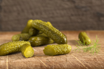 Marinated cucumbers or pickles on wood