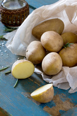 Harvest potato is young on a wooden vintage background, selectiv