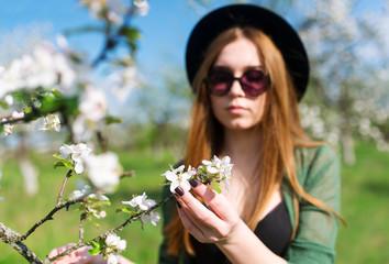 The girl model in an apple tree garden.