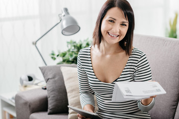 Woman checking household bills