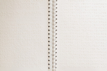 Close up of paper page with braille text.