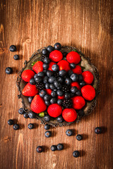 blueberries and strawberries on a plate stone background