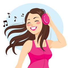 Beautiful young brunette woman listening music with headphones