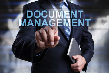 Businessman is pressing on virtual screen and selecting Document management.