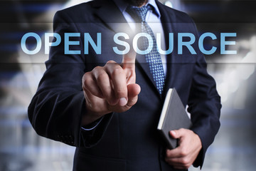 Businessman is pressing on virtual screen and selecting Open source.