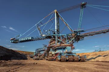 Large excavator machine in the mine