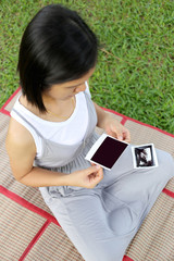 Asian Pregnant women show ultrasound film baby picture on her be