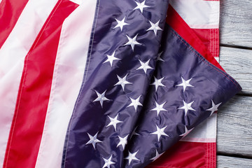 Creased and crumpled american flag. Flag with stars and stripes. Peace, equality and freedom. Country with rich history.