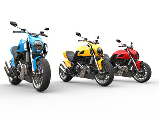 Three sports motorcycles in a row - studio shot - isolated on white background