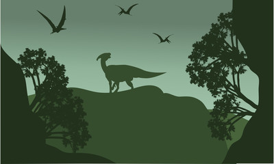 Silhouatte of parasaurolophus and pterodactyl