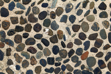 Background texture of floor gravel stone in sepia tone