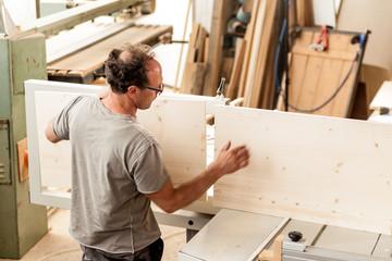 woodworker assembling a piece of furniture
