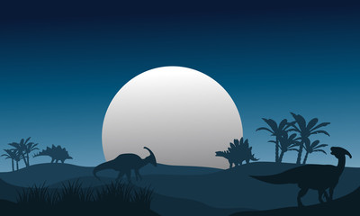 Silhouette of stegosaurus and parasaurolophus