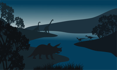 Landscape dinosaur silhouette in river