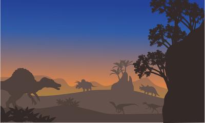 Silhouette of eoraptor and spinosaurus