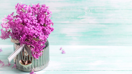 Flowers on wooden background.