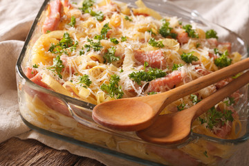Austrian cuisine: noodles baked with ham and cheese close-up. Horizontal
