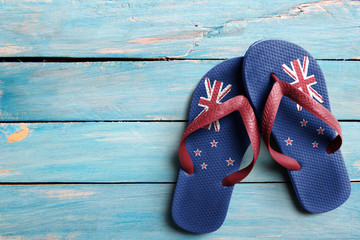 Thongs with flag of New Zealand, on blue wooden boards
