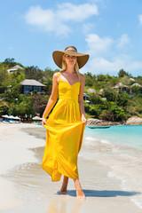 Carefree beautiful fashion blonde girl in long yellow dress flying ... 435460b467ff