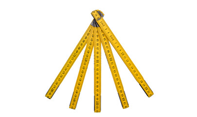 Folding ruler isolated, yellow carpenter's rule with centimeters numbers.