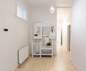 Large spacious entry foyer in beach style decorated apartment