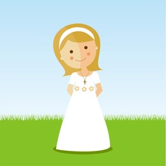 First Communion girl with blond hair in a park