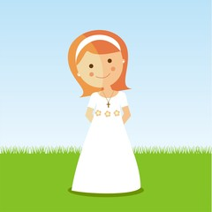 First Communion girl with red hair in a park