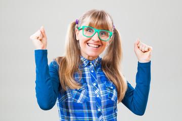 Studio shot portrait of cheerful nerdy woman