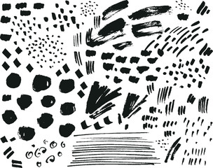 Collection of black ink brush points, spatters, marks and stroke