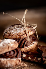 Maroni cookies with pieces of chocolate on old wooden background