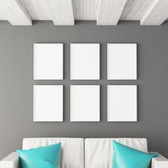 Sei quadri bianchi appesi a parete con divano pelle