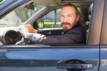 Driver of modern suv, portrait in open car window