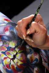 artist's hand on the body art