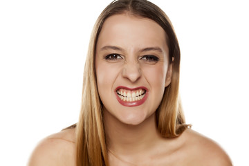 young woman gnash her teeth