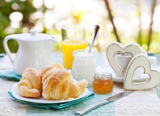 Romantic breakfast Croissants, coffee, juice