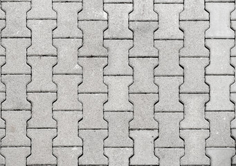 Concrete or cobble gray H Shaped  pavement slabs or stones. Wall mural