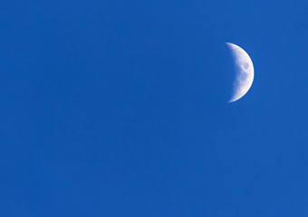 waxing moon on a background of blue sky