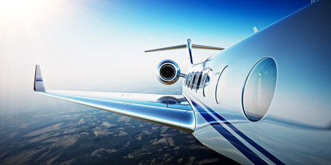 Closeup Photo of White Luxury Generic Design Private Aircraft Flying in Blue Sky at sunrise.Uninhabited Desert Mountains Background.Business Travel Picture.Horizontal,Film Effect. 3D rendering.