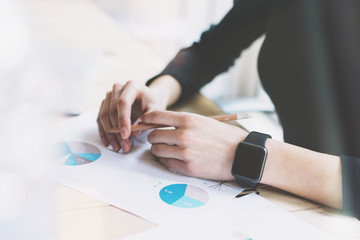 Picture Woman Working Modern Office.Girl Wearing Generic Design Smart Watch.Female Hands holding pencil. Account Manager Work Process at Wood Table.Horizontal mockup.Burred Background. Film effect