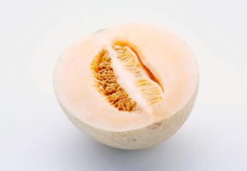 Half cantaloupe isolated on white background
