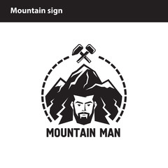 sign of man on a background of mountains