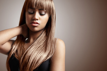 black woman with a long stright hair