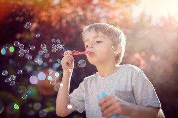 Blowing summer soap bubbles