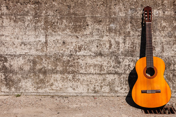 Guitar leaning on wall.