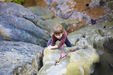 A bold child is climbing.