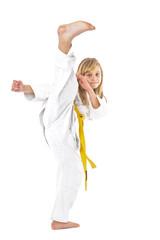 Portrait of little girl training ashihara martial art
