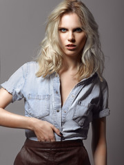 Portrait of a beautiful blonde girl in a denim jacket
