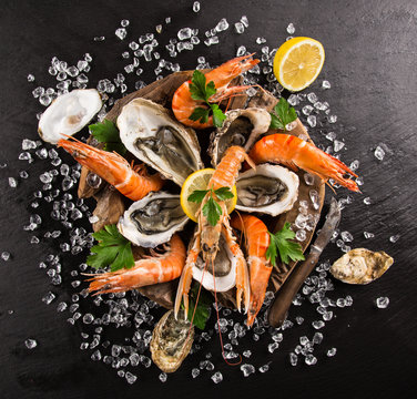 Fresh seafood on black stone.