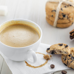 Cup of coffee with sweet homemade cookies. Coffee break with chocolate biscuits.
